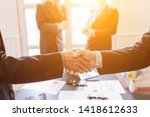 Small photo of Smooth Focus,Businessmen shaking hands with the company's business consultants to agree on a contract of employment because the investment advisor has been successful and the results are satisfactory.