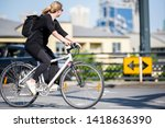 Small photo of Woman on bicycle and cycling rides are great tools for improving the health of the muscles of the hip belt reducing weight and improving female libido improving psychological stability in lifestyle