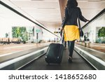 Woman Traveller With Travel...