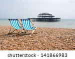 Deck Chairs On The Beach In...