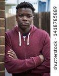 portrait of teenage boy leaning ...   Shutterstock . vector #1418785889