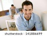 smiling successful man standing ... | Shutterstock . vector #141886699