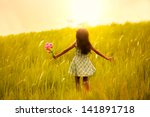Little Girl Running On Meadow...