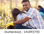 handsome teen volunteer... | Shutterstock . vector #141892750