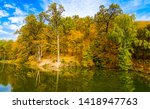 forest river island in autumn.... | Shutterstock . vector #1418947763