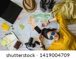 Small photo of Travel planning concept with map. Overhead view of equipment for travelers. Background travel ideas young women sleeping smiling on the map. concept on vacation trip, map, Travel Thailand.