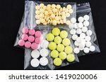 pink  white and yellow pills in ... | Shutterstock . vector #1419020006
