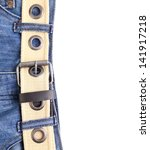 Blue jeans and leather belt are located left on the white background - stock photo