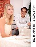 customers in a restaurant   Shutterstock . vector #141926449