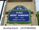 """Street name sign in Paris indicating: """"Place André Honnorat, 1868-1950, Politician."""" Place André Honnorat. 1868-1950. Homme politique."""