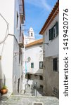 typical narrow winding street... | Shutterstock . vector #1419420776