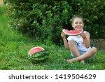 happy little child girl eating... | Shutterstock . vector #1419504629