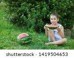 happy little child girl eating... | Shutterstock . vector #1419504653