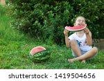 happy little child girl eating... | Shutterstock . vector #1419504656