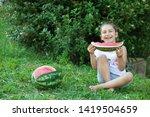 happy little child girl eating... | Shutterstock . vector #1419504659