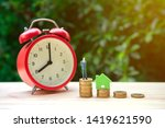 growing coin stack and clock... | Shutterstock . vector #1419621590