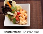 Thailand style seafood salad with clear vermicelli style rice noodles and veggies. - stock photo