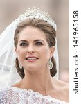 Small photo of STOCKHOLM, Sweden - JUNE 8: The face of Princess Madeleine on the way to Riddarholmen after the wedding with Chris O´Neill in Slottskyrkan. June 8, 2013, Stockholm, Sweden