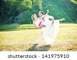 Bride And Groom Dancing The...