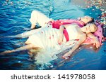 the bride and groom in their... | Shutterstock . vector #141978058