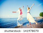 bride and groom on the beach.... | Shutterstock . vector #141978070