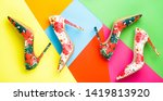 Small photo of Bright colored women shoes. Beauty fashion concept, stiletto. Stylish female shoes in colors. Colorful leather shoes stiletto. Women shoe on color background. Stylish classic women leather shoe.