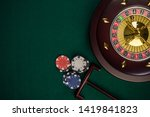 Wooden Roulette Drum on Green Casino Felt Table, Border BAckground, Top View. - stock photo