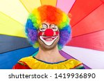 colorful clown face on a... | Shutterstock . vector #1419936890