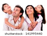 happy family portrait looking... | Shutterstock . vector #141995440