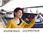 asian woman call a taxi car... | Shutterstock . vector #1419957929