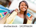 Female Shopper With A Credit...