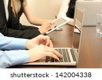 male hands with laptop on... | Shutterstock . vector #142004338
