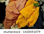 pile of clothes. closedup of...   Shutterstock . vector #1420051079