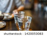 water glass on the table | Shutterstock . vector #1420053083
