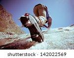 Climber Climbs On Ice.