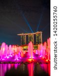 Small photo of SINGAPORE CITY, SINGAPORE - MARCH 2, 2019: Spectra Light and Water Show Marina Bay Sand Casino Hotel Downtown Singapore