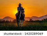 silhouette cowboy on horseback... | Shutterstock . vector #1420289069