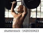mature black bodybuilder doing...   Shutterstock . vector #1420310423