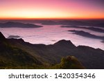beautiful sunrise and mist at... | Shutterstock . vector #1420354346