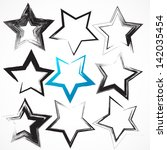 vector set of grunge star brush ... | Shutterstock .eps vector #142035454