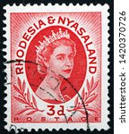 Small photo of ZAGREB, CROATIA - JUNE 2, 2019: a stamp printed in Rhodesia shows Elizabeth II, Queen of the United Kingdom and the other Commonwealth realms, portrait, circa 1954
