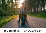 motorcycle on the forest road... | Shutterstock . vector #1420378169