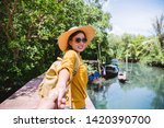 asian couple holding hands ... | Shutterstock . vector #1420390700