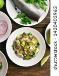 Stock photo herring salad with potato onion marinated cucumber and apple on wooden table top view flat lay 1420403963