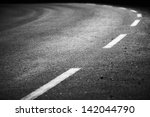 turning asphalt road with... | Shutterstock . vector #142044790