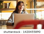 woman working on a laptop on a... | Shutterstock . vector #1420455890