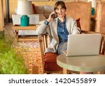 woman working on a laptop on a... | Shutterstock . vector #1420455899