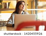 woman working on a laptop on a... | Shutterstock . vector #1420455926