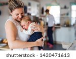a beautiful young mother with a ... | Shutterstock . vector #1420471613