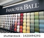 Small photo of BAKEWELL, UNITED KINGDOM, 9th June 2019: A Farrow and Ball paint chart on a wall in a painting and decorating shop
